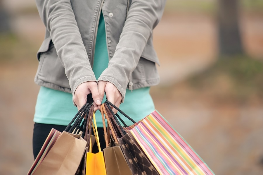 A woman with multiple shopping bags | closeup images.